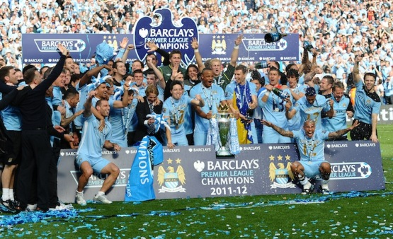 Manchester City players celebrate with the Premier League trophy after their 3-2 victory over Queens Park Rangers in the English Premier League football match between Manchester City and Queens Park Rangers at The Etihad stadium in Manchester, north-west England on May 13, 2012. Manchester City won the game 3-2 to secure their first title since 1968. This is the first time that the Premier league title has been decided on goal-difference, Manchester City and Manchester United both finishing on 89 points. AFP PHOTO/PAUL ELLISRESTRICTED TO EDITORIAL USE. No use with unauthorized audio, video, data, fixture lists, club/league logos or 'live' services. Online in-match use limited to 45 images, no video emulation. No use in betting, games or single club/league/player publications.        (Photo credit should read PAUL ELLIS/AFP/GettyImages)