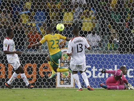 South Africa's Tokelo Rantie, second left, scores past Mali's goalkeeper Soumaila Diakite, right, Molla Wague, second right, and Adama Tamboura in their African Cup of Nations quarterfinal match at Moses Mabhida Stadium in Durban, South Africa, Saturday, Feb. 2, 2013. (AP Photo/Rebecca Blackwell)