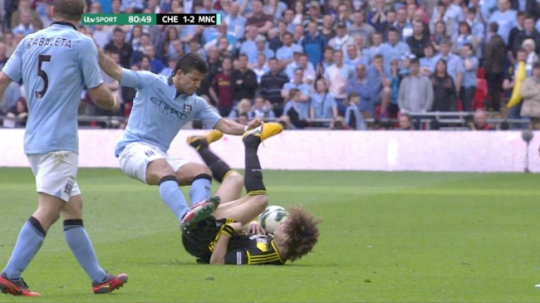 ENTERPRISE NEWS AND PICTURES                                  14/4/13 PIC SHOWS: HD replay grab of Man City's Sergio Aguero's dangerous two-footed jump on top of Chelsea's David Luiz which should have received a red card but went unpunished today in the FA Cup semi final, shown live on ITV1 HD. See story...