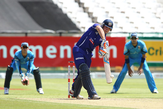 CAPE TOWN, SOUTH AFRICA - DECEMBER 09, Stiaan van Zyl of the Cape Cobras drives a delivery straight during the Momentum One Day Cup Eliminator match between Nashua Mobile Cape Cobras and Nashua Titans at Sahara Park Newlands on December 09, 2012 in Cape T