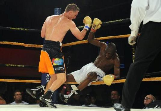 Ryno Liebenberg, left, knocks Flash Issaka, of Ghana, out of the ring, 16 February 2013, during their IBO All Africa Light Heavyweight Title fight, during the Danger Zone boxing tournament, in association with SuperSport, Emperors Palace and Golden Gloves, in Johannesburg. Liebenberg won the fight on a TKO retaining his title. Picture: Michel Bega