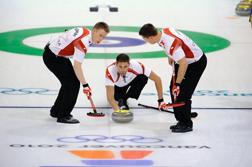 Vancouver 2010 Winter OG, Curling Men - Semi-final, Sweden (SWE) - Canada (CAN) 1st. Marc KENNEDY, John MORRIS and Ben HEBERT(CAN).