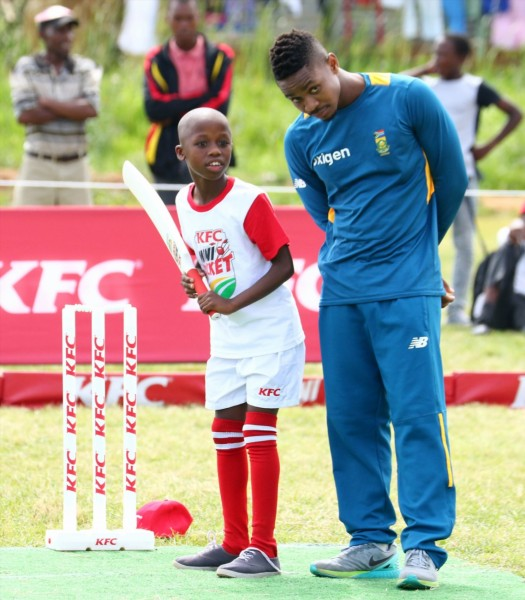 1. Khaya Zondo from the Proteas monitors one of the KFC Mini-Cricket kids